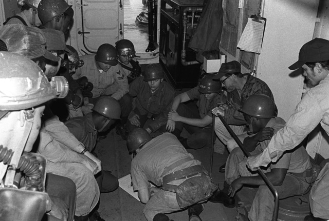Repair Party No. 3 participates in a training session during a general quarters drill aboard the salvage ship USS OPPORTUNE (ARS 41) on the 40th anniversary of the attack on Pearl Harbor