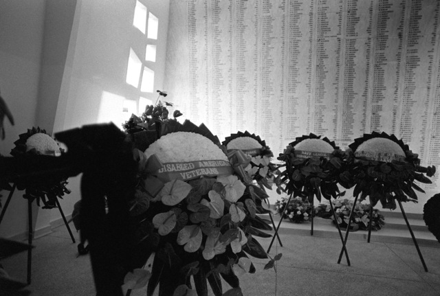 Wreaths to be presented during the ceremony commemorating the 40th anniversary of the Japanese attack on Pearl Harbor are lined up in the shrine room of the USS ARIZONA Memorial
