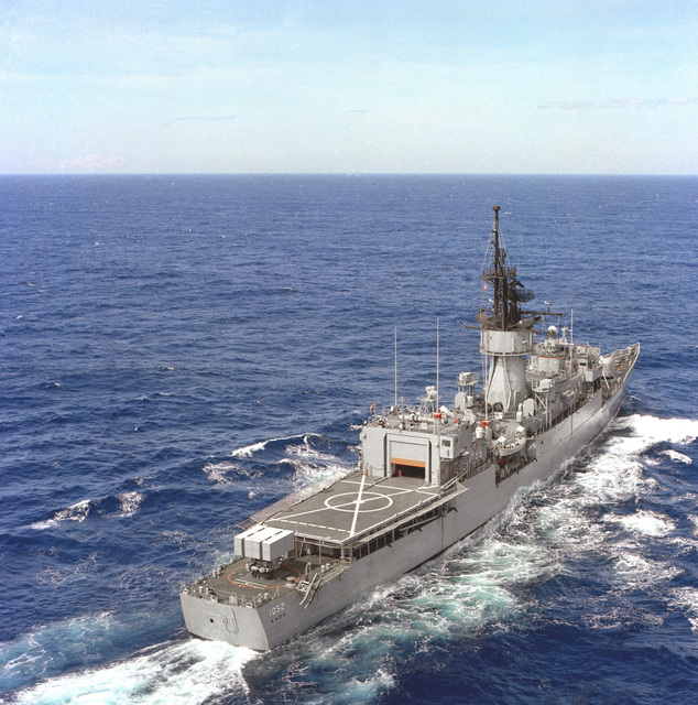 Aerial starboard quarter view of the frigate USS KNOX (FF-1052) underway off the coast of Luzon, Republic of the Philippines