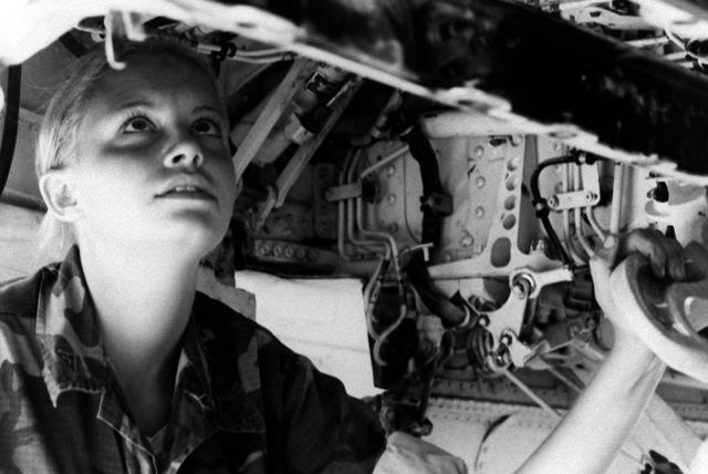 Lance CPL. Regina Martin, a plane captain with Marine Light Attack Squadron 223 (VMA-223), checks the condition of her aircraft
