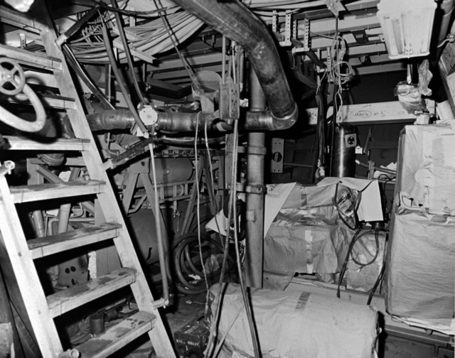 An interior view of the air conditioning machinery room on the guided missile frigate USS CROMMELIN (FFG 37) at 40 percent completion
