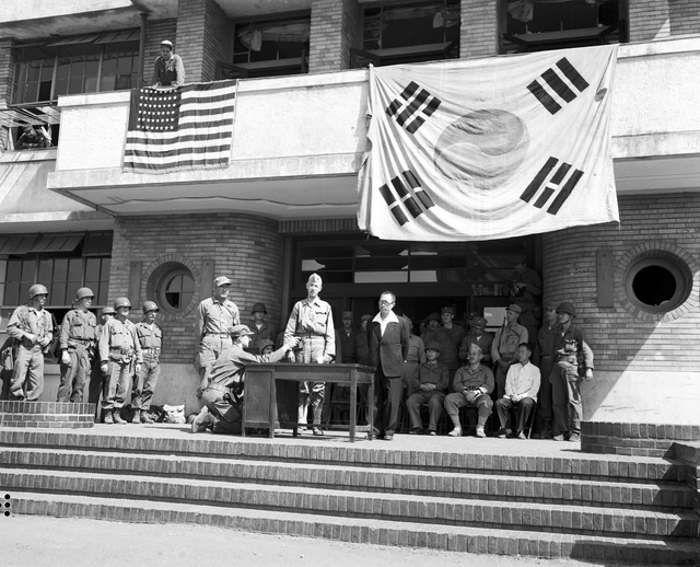 Major General Oliver P. Smith, Commanding 1st Marine Division, Returns Civil Government to Mayor of Inchon on Behalf of United Nations