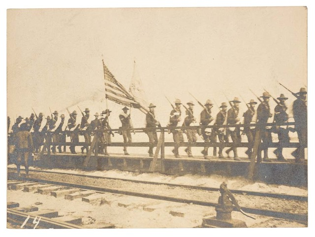 Photograph of Troops Marching Next to Railroad Tracks
