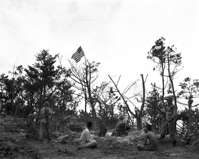 The War is Over for These Korean Captives of U.S. Marines who have Planted their Flag Atop Wolmi Island, at Inchon