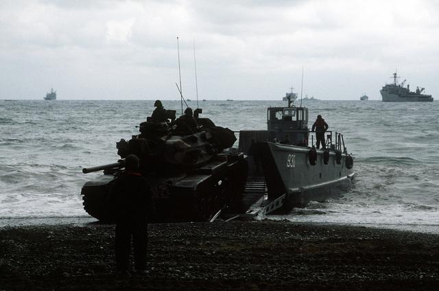 A combat tank, aboard a mechanized landing craft (LCM-8), lands during Valiant Blitz, the amphibious assault landing phase of exercise Team Spirit '82