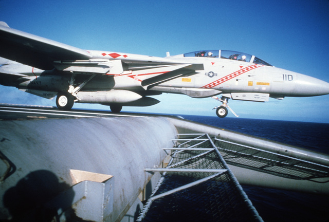 A Fighter Squadron 102 (VF-102) F-14A Tomcat aircraft clears the deck of the aircraft carrier USS AMERICA (CV 66) after being launched