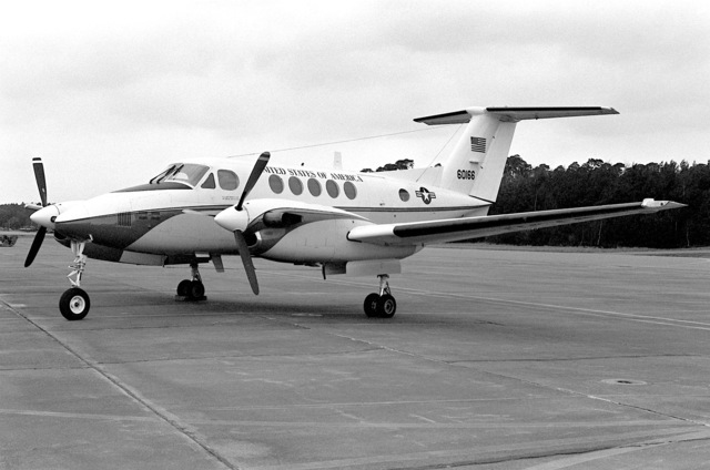 A left front view of a parked C-12 Huron aircraft