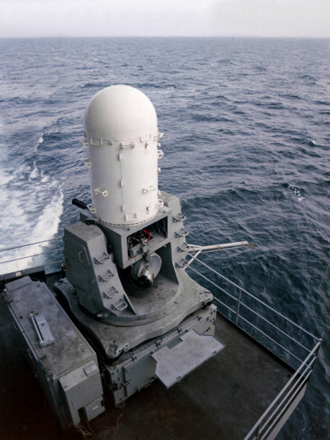 A rear view of one of the three Phalanx Mark 15 (3X1) weapons systems installed on the aircraft carrier USS AMERICA (CV-66). The 20mm gun is capable of firing 3,000 rounds-per-minute and simultaneously measuring the location of both target and projectiles in flight and automatically correcting the fire control solution