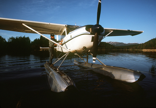 A view of a seaplane sitting idle in the water, a common means of transportation in this territory