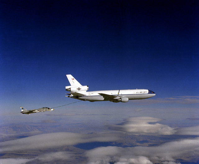 Air-to-air right side view of a KC-10A Extender aircraft refueling an F-14 Tomcat aircraft