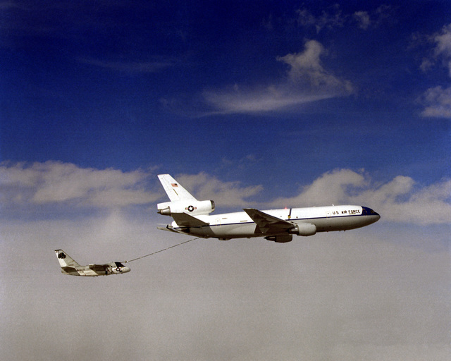 Air-to-air right side view of a KC-10A Extender aircraft refueling an S-3A Viking aircraft