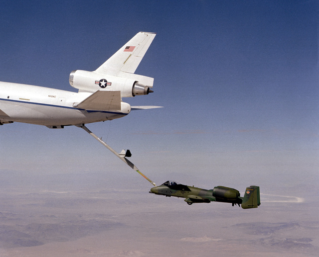 An A-10A Thunderbolt II aircraft is refueled through the boom of a KC-10A Extender aircraft