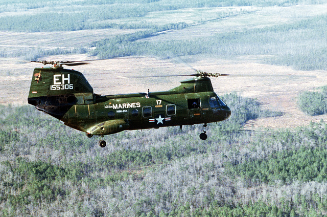 An air-to-air right side view of a Marine CH-46E Sea Knight helicopter from Marine Medium Helicopter Squadron 264 (HMM-264)