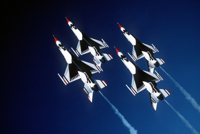 An air-to-air underside view of a four-ship diamond formation of the Thunderbirds Flight Demonstration Team's F-16 Fighting Falcon aircraft during flight maneuver training