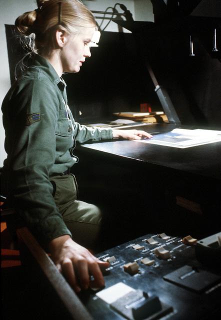 AN airman 1ST class works in an office