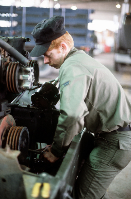 AN airman works on equipment
