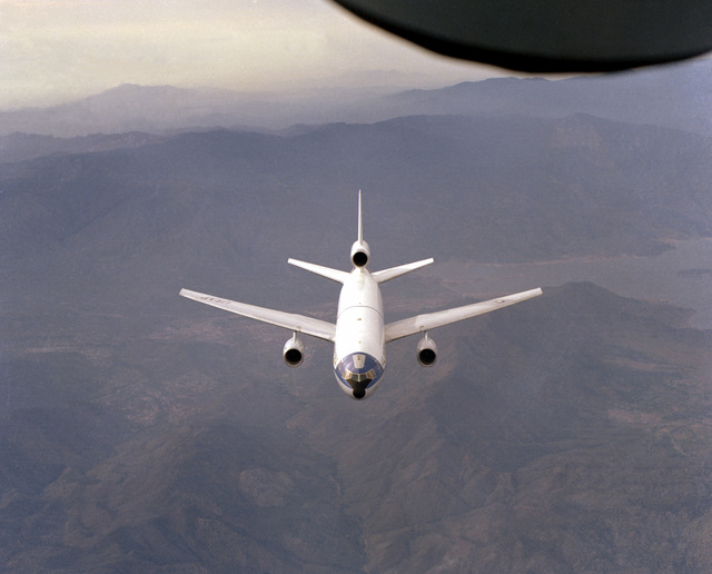 An overhead front view of a KC-10A Extender aircraft as seen from the boom operator's position of a KC-135 Stratotanker aircraft