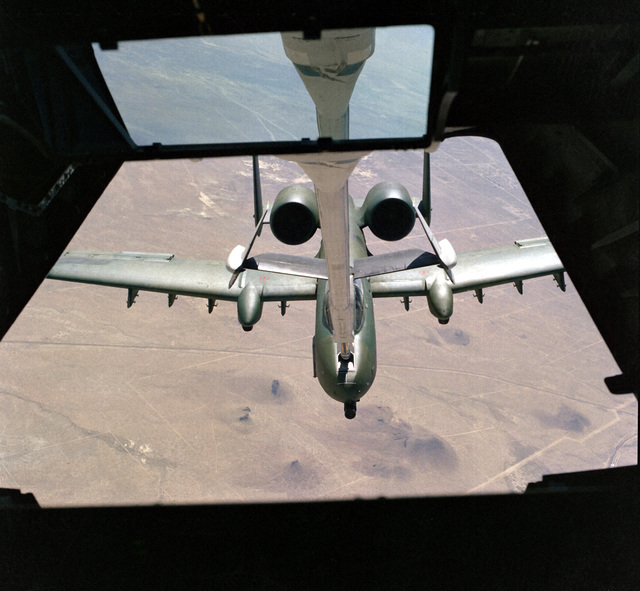 An overhead front view of an A-10 Thunderbolt II aircraft being refueled by a KC-10A Extender aircraft as seen from the boom operator's position