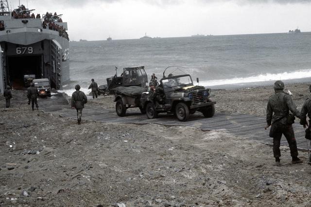 Korean Marine Corps vehicles, aboard a tank landing ship (LST-679), land during Valiant Blitz, the amphibious assault landing phase of exercise Team Spirit '82