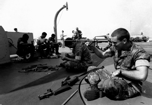 LCPL David Williams, right, and other Marines clean their M-16 rifles aboard the tank landing ship USS FRESNO (LST-1182) during the trip to Korea to participate in exercise Team Spirit '82