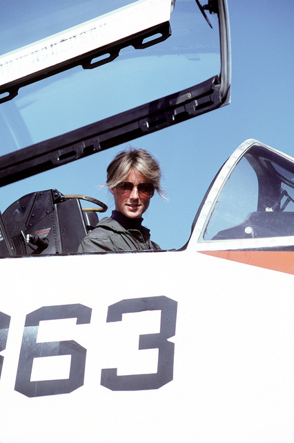 LT. Patricia A. Denkler, assigned to Training Squadron 4 (VT-4), sits in the cockpit of her TA-4J Skyhawk aircraft. Denkler became the first Navy woman to be carrier qualified in a jet aircraft when she landed aboard the aircraft carrier USS LEXINGTON (AVT-16) in September