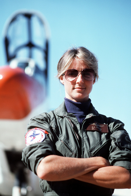 LT. Patricia A. Denkler, assigned to Training Squadron 4 (VT-4), stands in front of a TA-4J Skyhawk aircraft. Denkler became the first Navy woman to be carrier qualified in a jet aircraft when she landed aboard the aircraft carrier USS LEXINGTON (AVT-16) in September