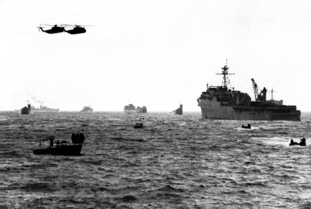 Two Marine Corps CH-53 Sea Stallion helicopters transport troops and equipment to the beach as U.S. and Korean combatant ships and landing craft take part in Valiant Blitz, the amphibious assault landing phase of exercise Team Spirit '82
