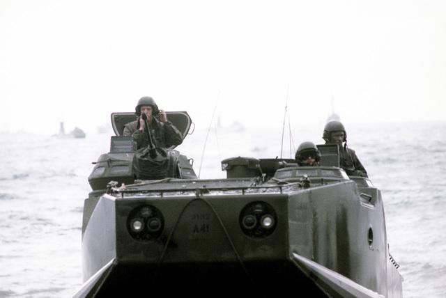 U.S. Marines, aboard a tracked landing vehicle (LVTP-7), land during Valiant Blitz, the amphibious assault landing phase of exercise Team Spirit '82