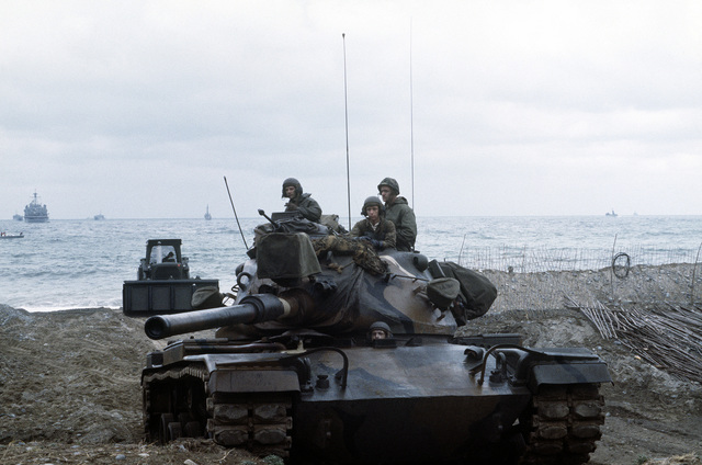 U.S. Marines, aboard an M-60A1 tank, land during Valiant Blitz, the amphibious assault phase of exercise Team Spirit '82