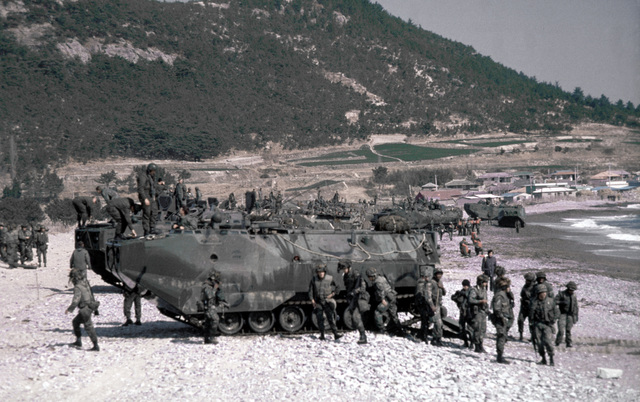 U.S. Marines, aboard tracked landing vehicle (LVTP-7), land during Valiant Blitz, the amphibious assault landing phase of exercise Team Spirit '82