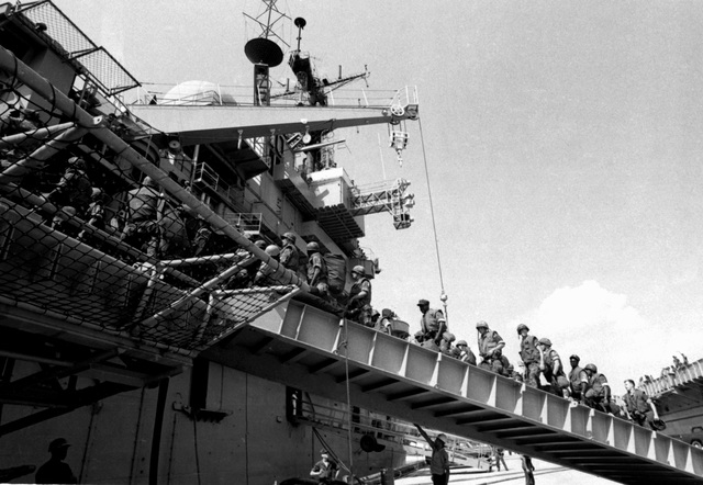 U.S. Marines board the amphibious assault ship USS TRIPOLI (LPH-10) for the trip to South Korea to participate in exercise Team Spirit '82