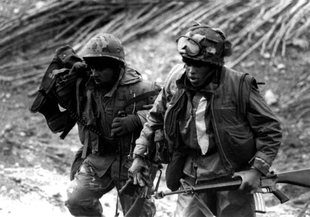 U.S. Marines head inland during Valiant Blitz, the amphibious assault landing phase of exercise Team Spirit '82