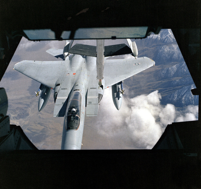 View from the boom operator's position of an F-15A Eagle aircraft being refueled by a KC-10A Extender aircraft