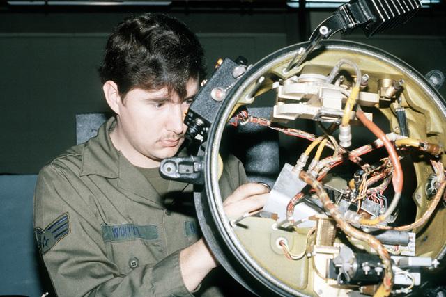 SRA Richard G. White, radar and navigational section, 316th Field Maintenance Squadron, repairs a radar system
