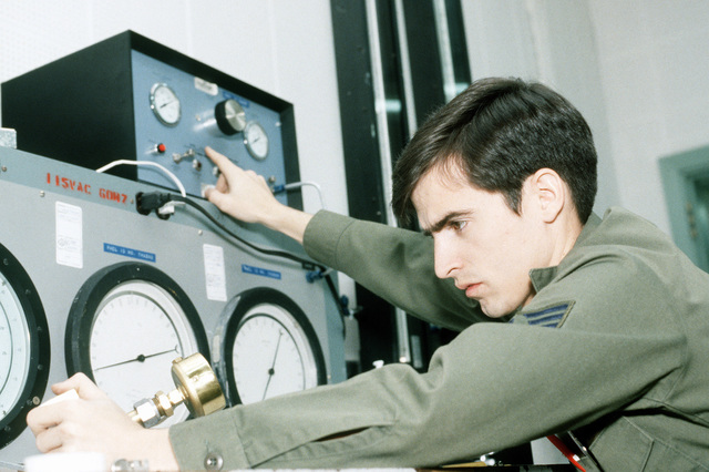 SSGT Stephen C. Henisa, Precision Measurement Section (Avionics), 316th Field Maintenance Squadron, uses high-pressure test equipment to calibrate a pressure gauge