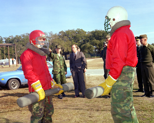 Mr. Walter, assistant secretary of the Army and MGEN Haebel are shown the art of using the pugil stick, during their tour of the Marine Corps Recruit Depot