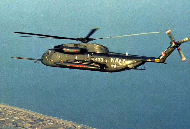 An air-to-air left side view of an RH-53D Sea Stallion helicopter from Helicopter Mine Countermeasures Squadron 12 (HM-12)