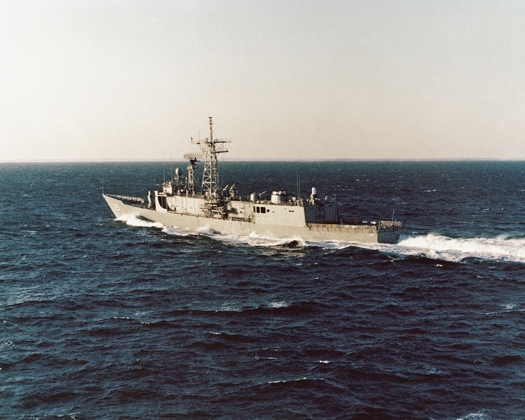 Aerial port quarter view of the Oliver Hazard Perry class guided missile frigate USS STEPHEN W. GROVES (FFG 29) underway during sea trials