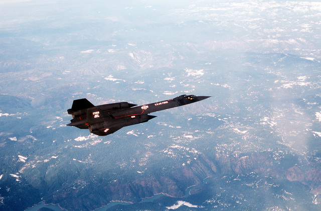 An air-to-air right top view of an SR-71 Blackbird aircraft during its 1,000th sortie