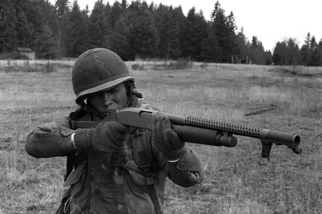 PFC. Art Burgess, a candidate in the Ranger Indoctrination Program (RIP), 2nd Battalion, 75th Infantry (Ranger), fires a Winchester-built combat shotgun during special weapons training at Range 31