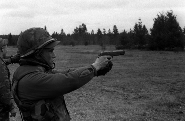 PFC Dennie Pack, a candidate in the Ranger Indoctrination Program (RIP), fires an M-1611A1 .45-caliber pistol during RIP special weapons training at Range 31