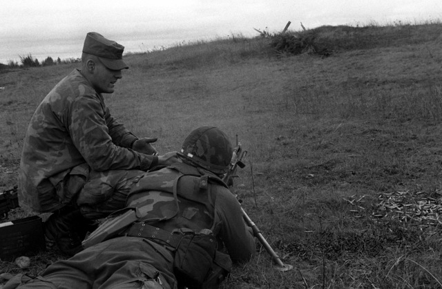 PFC Jim Williams, a candidate in the Ranger Indoctrination Program (RIP), 2nd Battalion, 75th Infantry (Ranger), fires an M-60 machine gun under the supervision of SGT Gary King during special weapons training on Range 31