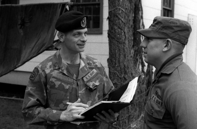 SSGT Ronald Klumeper, non-commissioned officer in charge, Ranger Indoctrination Program (RIP), counsels PFC James Lee, 2nd Battalion, 75th Infantry (Ranger), on upcoming training