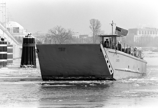 A port bow view of a utility landing craft being used by Navy divers in an operation to recover victims and wreckage from Flight 90, the Air Florida Boeing 737 that crashed into Rochambeau Bridge (14th Street). The divers are from the Explosive Ordnance Disposal School at Indian Head, Maryland and Harbor Clearance Unit Two, from Little Creek, Virginia