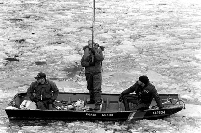 Members of the U.S. Coast Guard assist a survey team in plotting the wreckage from Flight 90, the Air Florida Boeing 737 that crashed into Rochambeau Bridge (14th Street)