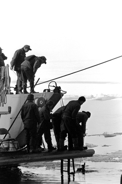 Navy divers participate in the recovery of the victims and wreckage from Flight 90, the Air Florida Boeing 737 that crashed into Rochambeau Bridge (14th Street). The divers are from the Explosive Ordnance Disposal School at Indian Head, Maryland, and Harbor Clearance Unit Two, from Little Creek, Virginia