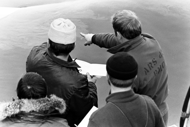 SENIOR Navy divers use a schematic diagram of a Boeing 737 to help in the recovery of the tail section from Flight 90, the Air Florida aircraft that crashed into Rochambeau Bridge (14th Street). The divers are from the Explosive Ordnance Disposal School at Indian Head, Maryland and Harbor Clearance Unit Two, from Little Creek, Virginia