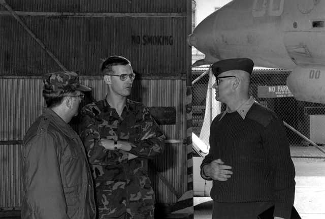 Chaplain of the Marine Corps, CAPT. George W. Evans, is given a tour of the station by the Marine Air Group-12 Chaplain, CMDR. Donald L. Thacker. GUNNERY SGT. Harold G. Hays (center) gives Evans a short briefing about his section