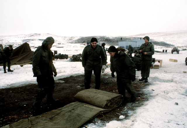 Marines from Company B, 1ST Tank Battalion, unroll a tent as they prepare to set up for their cold weather training