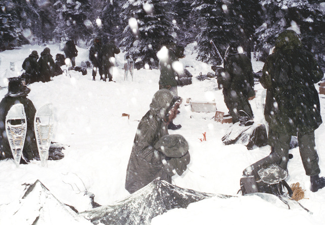 While standing in deep snow, Marines from Company B, 1ST Tank Battalion, get ready to start their cold weather training for that day